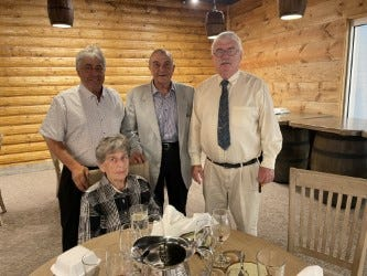 Dick Sieb (standing, middle) was honored by the River Raisin National Battlefield at its newly remodeled Education Center Wednesday night. Accompanying him were his wife, Marge (sitting); son Rob (left) and friend David Eby.