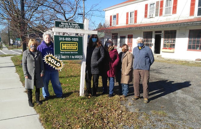 Nelson Preservation Associates members, from left, Laine Gilmore, Nancy Demyttenaere, Rosalyn Bandy, Patricia Groff, Tracy Carman and Carl Stearns pose in 2020 outside the former Magee antique shop in Nelson. They are restoring it to its original purpose as a drover's stop along the highway.