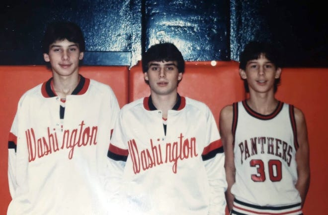 Former Washington basketball players JT Tyler, center, is in between his brothers Troy Tyler, left, and Jeff Tyler in this 1989 photo. JT was found dead in 2019 and now his brothers are stepping up to raise money for his children.