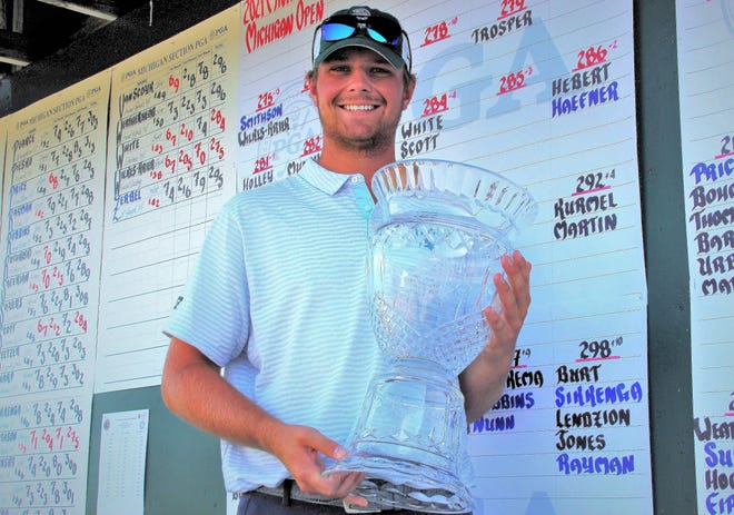 Bradley Smithson, a 20-year-old Michigan State University golfer, is all smiles after capturing the Michigan Open Thursday at Grand Traverse Resort.