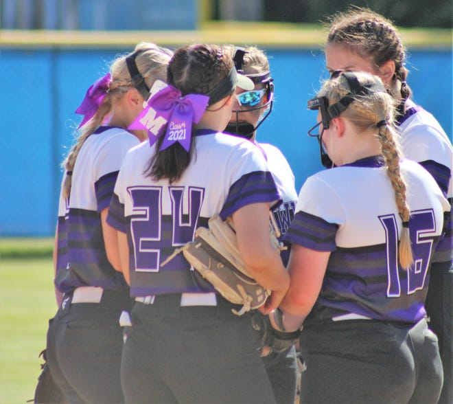 Members of the Marshwood High School softball team gather during Thursday's Class A South regional final against Biddeford at St. Joseph's College in Standish, Maine.