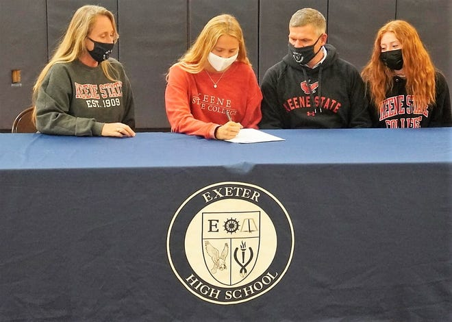 Exeter High School senior Samantha Taylor, second from left, will join the Keene State College women's swim team next year. The Brentwood resident, who plans to study Elementary Education and Psychology, is seated with her mother, Stacey; her father, David; and her sister, Sydney.