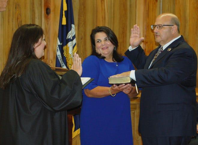 Sheriff Brett Stassi is sworn in as LSA Board President by District Judge Elizabeth Engolio. Holding the Bible is Brett's wife, Caroline.