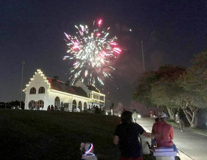 """Fireworks illuminate the skies over the Gary J. Hebert Memorial Lockhouse at the Plaquemine Lock State Historic Site. The fireworks display will cap off festivities for the Fourth of July event, sponsored by the Plaquemine Main Street Program, at Mark A. """"Tony"""" Gulotta Waterfront Park."""
