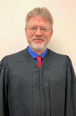 helps County Associate Circuit Judge Mark Calvert