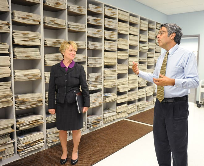 Record-Courier Editor Roger Di Paolo gives a tour of the newspaper's offices to Kent State University President Beverly Warren in July 2014.