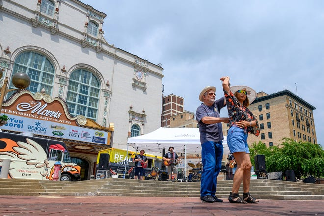 Robert Pinter and Dao Mikel dance to the music of the Van Dyke Revue at the John R. Hunt Plaza in South Bend during the Fridays by the Fountain event.