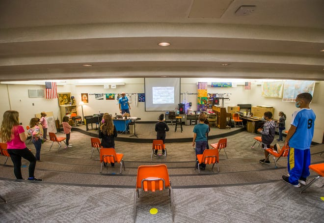 Students sit socially distance as they participate in music class on Friday, Nov. 6, 2020, inside Hums Elementary School in Mishawaka.