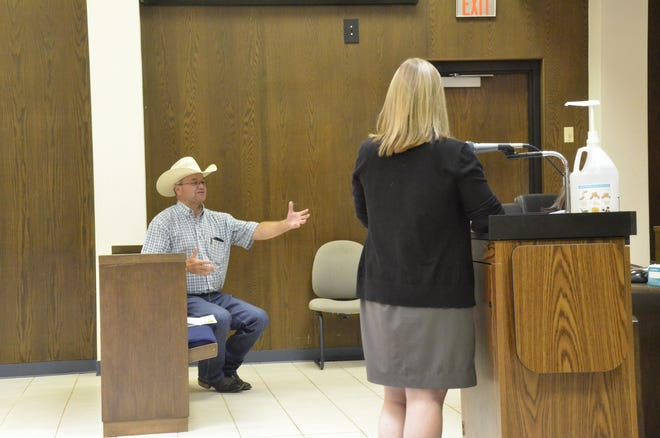 IFYR Event Director Dale Yerigan, at left, gives a report on progress regarding preparations for this year's IFYR as Spectra's general manager over the Heart of Oklahoma Exposition Center, Katy Fleming, listens.