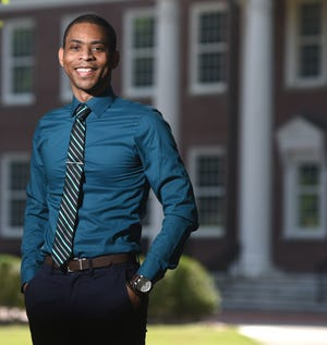 Emmanuel Mitcham, Marketing and Communications Specialist at UNCW, stands in front of Hoggard Hall in Wilmington, N.C., Friday, June 18, 2021. Mitcham is one of the StarNews 40 Under 40 honorees for 2021.