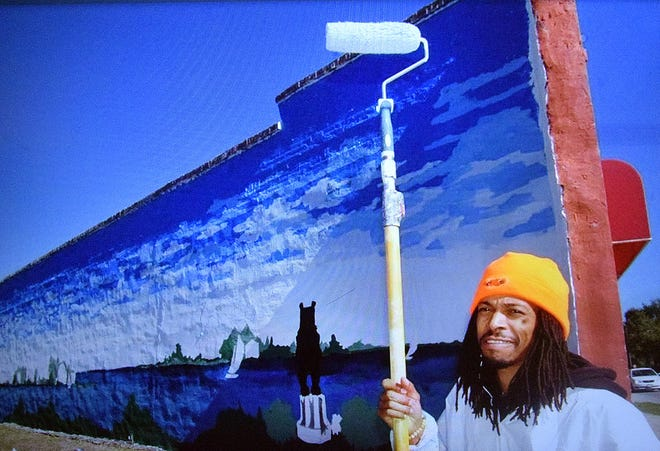 Derrick Bryant has maintained a scenic mural on the side of his mother's Designing Image salon for many years in Five Points.