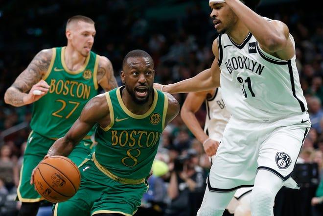 Boston Celtics' Kemba Walker (8) was traded to Oklahoma City on Friday.
