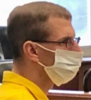 "Jeffrey J. ""James"" Exon listened to testimony at his preliminary hearing Thursday."