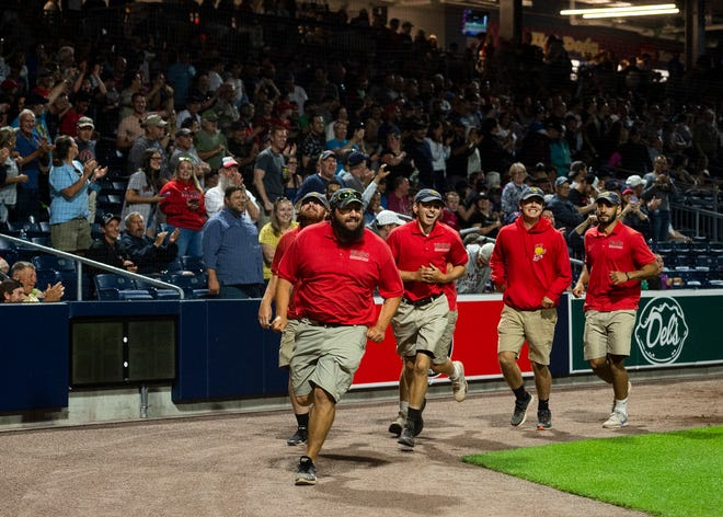 The grounds crew gets a loud round of applause from the fans after taking down a fan that ran on the field Thursday night during the game against Lehigh Valley at Polar Park.