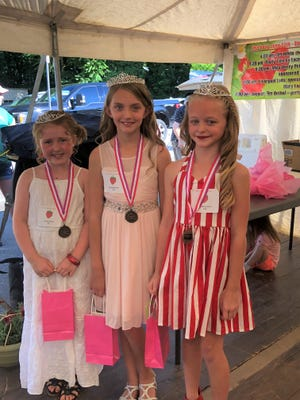 Maisyn Sluss (left), and McCall Symons (right) are attendants for the 2021  Miss Berry Princess, Maci Melching.