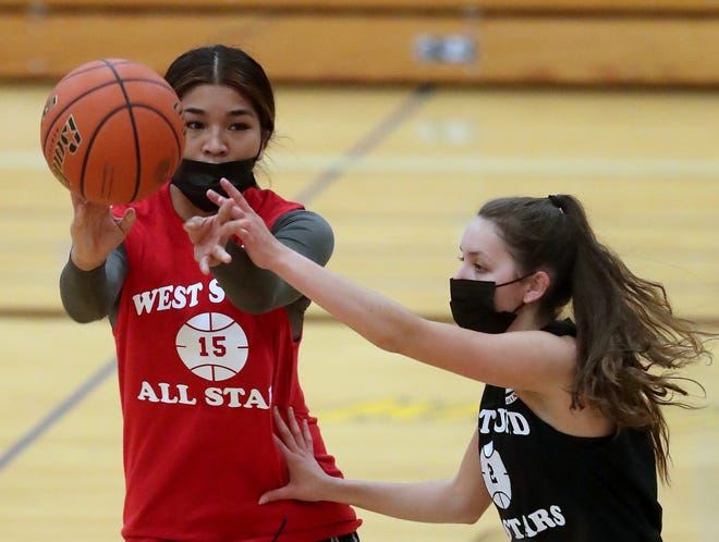 South Kitsap's Areeza Amian makes a pass while under the pressure of Kingston's Kylee Walker during the West Sound Senior High School All-Star Girls Basketball Game at Bremerton High School on Thursday, June 17, 2021.