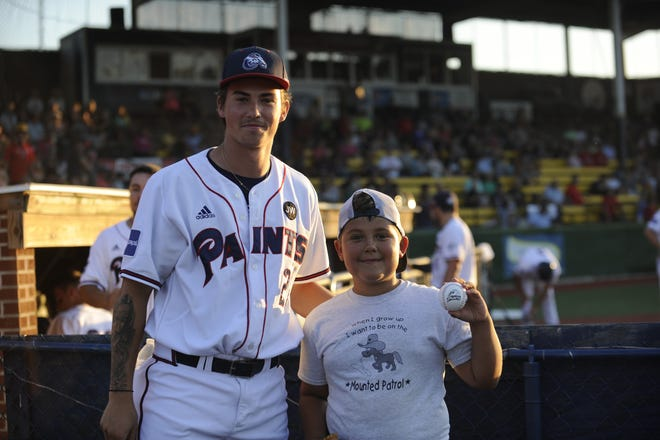 Pitcher Justin Diefenbach posing with a young fan.