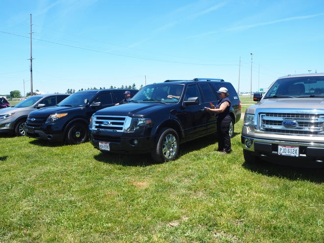 Six participants sat in warm vehicles to highlight the dangers of leaving children and pets in a vehicle with no air conditioning and only a window cracked.