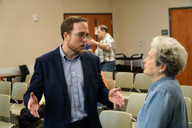 Protect the City Committee member Roddy Bergeron speaks to a constituent during a town hall meeting about the committee's draft report on Lafayette Consolidated Government on Monday, June 14, 2021.