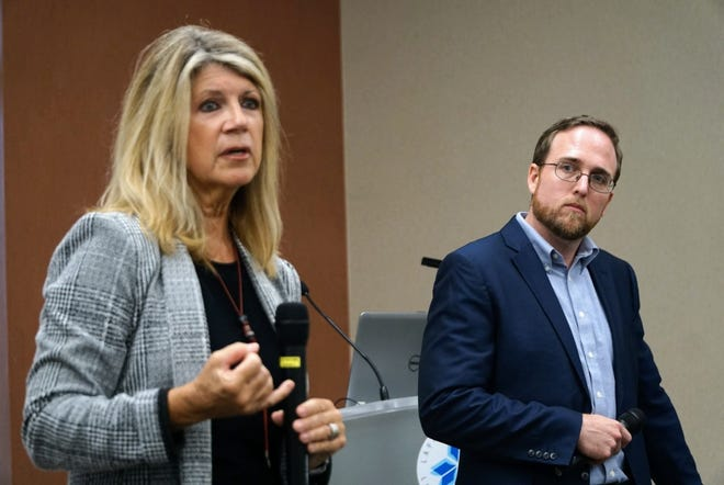 Protect the City Committee members Jan Swift (left) and Roddy Bergeron (right) present the findings of their committee's draft report on splitting up Lafayette Consolidated Government during a Monday, June 14, 2021, town hall meeting.