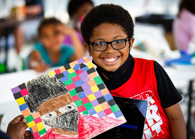 10-year-old D'Arius Taylor smiled while showing off the self-portrait he created during the Waterfront Park LVA Juneteenth camp on Friday, June 18, 2020