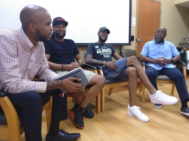 Brooks Griffin, a father engagement specialist with the African-American Breastfeeding Network leads a frank and open dialogue about the challenges of Black fatherhood and the need for Black men to support each other and be their own safety net Thursday, June 17 at All Saints Family Center, 2400 W. Villard Ave. Among the participants from left to right are the network's Griffin, Robert Brox, Shannon Reed and Alphonso Pettis, who operates the Mentoring through Arts and Sport Enrichment program. The men talked about the need to remove the fear surrounding being a new dad while embracing the joy of fatherhood.