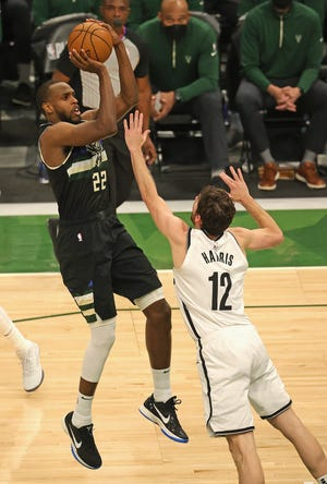 Khris Middleton shoots over Joe Harris in Game 6 of the Eastern Conference semifinals. Middleton had 38 points.