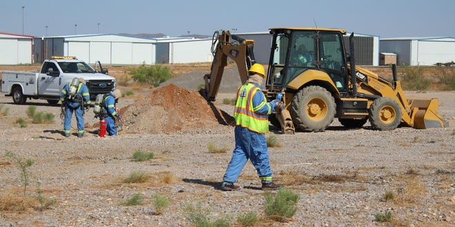 A Las Cruces Utilities work crew repairs a gas line during training exercise at Las Cruces International Airport.