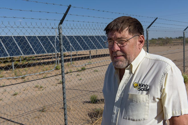 Nick King, a member of Citizens Caring for the Future's leadership team, stands in front of Carlsbad's Hopi Substation, a ten megawatt solar array that feeds power to the electric grid.