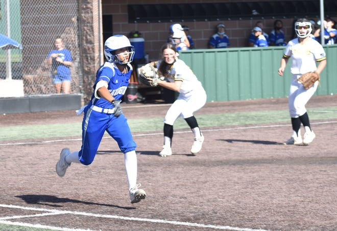 Madison Loera runs to first base after laying down a sacrifice bunt Thursday during a 6-5 extra-inning win over Hobbs at Veterans Memorial Complex.