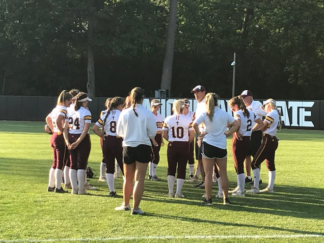 Mercy softball meets together after its Division 1 state semifinal loss to Allen Park.