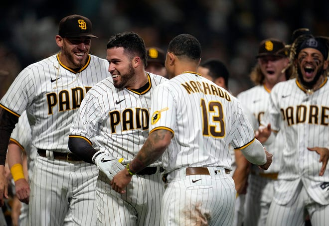 June 17: San Diego Padres catcher Victor Caratini celebrates with teammates after hitting a walk-off home run against the Cincinnati Reds at Petco Park.