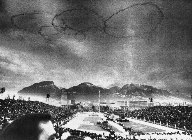 Smoke rings in the sky, formed by the exhaust of Airplanes, symbolize the 1968 Olympics, which opened with the winter games, Feb. 6, 1968, Grenoble, France.