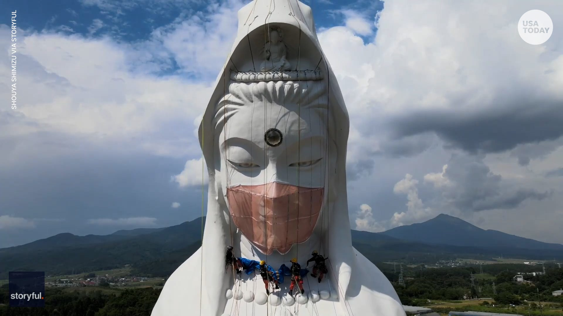 187-foot statue gets face mask to pray for end COVID-19 in Japan