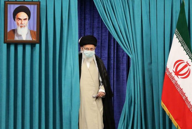 Supreme Leader Ayatollah Ali Khamenei  arrives to cast his ballot on June 18, 2021, in Iran's presidential election.