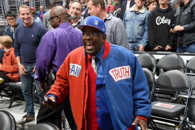 """""""Clipper Darrell,"""" who wears his customary red and blue three-piece suit, has been a staple at Clippers home games since 2000."""
