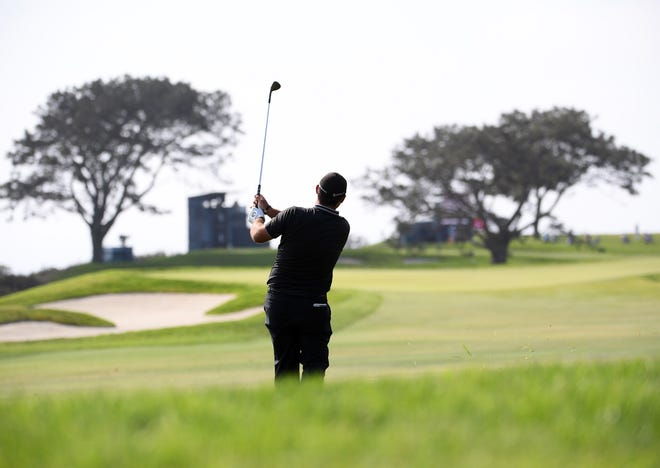 A golfer plays a shot on the 14th fairway during the 2021 U.S. Openat Torrey Pines Golf Course.