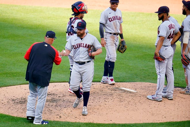 Cleveland relief pitcher Bryan Shaw, center left, hands the ball to manager Terry Francona, left, as he leaves the mound during the seventh inning of Saturday's game. [Gene J. Puskar / Associated Press]