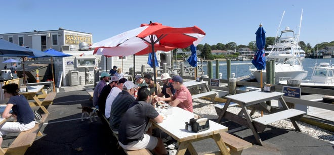 Diners sit on the deck overlooking the water at Baxter's Wharf in Hyannis.