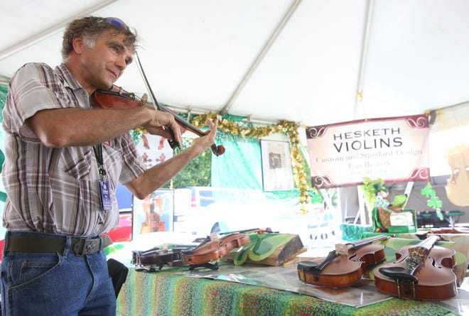 Ryan Hesketh of Carbondale Illinois plays one of his violins during the opening day of the Dublin Irish Festival in 2019