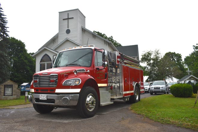 """Palmyra Township Fire Department's Engine 1 sits in front of Palmyra Community Presbyterian Church Saturday morning prior to the celebration of life service for longtime township resident and former fire chief Charles """"Chuck"""" Jackson, who died at the age of 100 in December."""