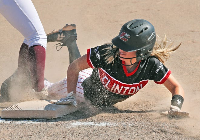 Clinton's Ava Ormsby slides into third during the Division 3 quarterfinal game at Concordia on Tuesday.