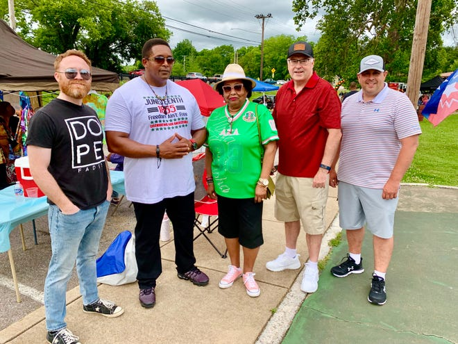 From left, city council members Danny Coleman and Tony Greene join Vice Mayor Christa Martin, City Manager Tony Massey and Columbia Police Chief Jeremy Alsup for Columbia's fifth annual Juneteenth CommUNITY Cookout at Riverwalk Park on Saturday, June 19, 2021.