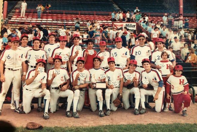 THEN: The Hornell Red Raiders celebrate after winning the 1981 Section V, Class AA title. Front row: J. Montemarano, C. Hogan, B. Quinlan, J. Lawrence, J. Tallman, E. Weyand, J. Kelleher, bat boy J. Dolan. Back row: B. Murray, T. Argentieri, T. Reardon, T. Burkhart, J. Connors, J. Dagon, J. Sirianni, R. Brown, T. Baumgarten, Coach Caruso, Coach Libordi, bat girl K. Caruso-Klabin.
