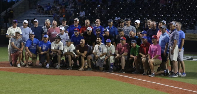 Former Hays Larks' players gather for a photo Friday night for the Larks celebration of their 75th anniversary season.