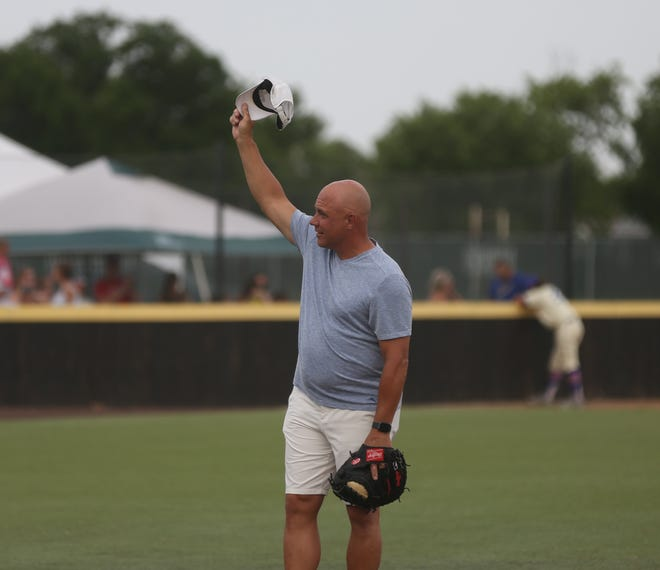 Former Hays Lark Jim Leyritz, who won two World Series championships with the New York Yankees, acknowledges the crowd before last Friday's game at Larks Park.