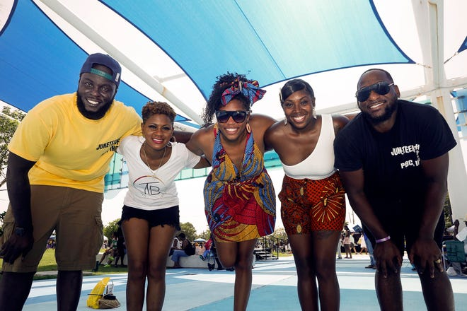 (L to R) Webster Casseus, Taraniesha Burgess, Brittany Mitchell, Sukeenah Kelly, and Chris McAfee helped to organize a Juneteenth festival at the Riviera Beach Marina Village, June 19, 2021. The event was free to the public and featured food, music from X102.3, local vendors, and fun and games for kids.