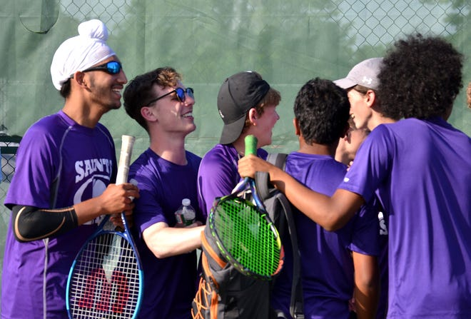 Members of the St. Raphael tennis team celebrate their victory over North Smithfield on Friday night.