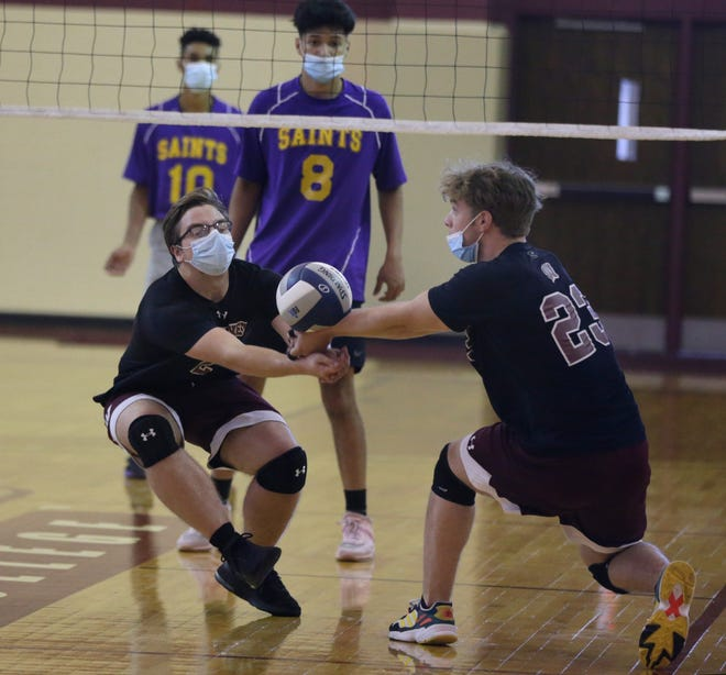 Woonsocket's Kacper Kurowski, left, and Elijah DiSpirito combined to make a save during Saturday's Division III title match against St. Raphael.