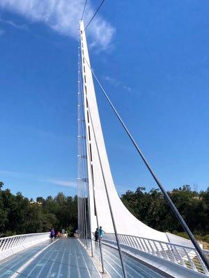 The Sundial Bridge, designed by the renowned architect Santiago Calatrava to mimic a 220-foot tall sundial, seemingly floats 720 feet across the Sacramento River.